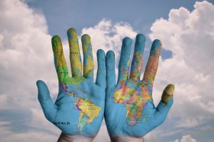 hands-with-worldmap