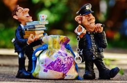 taxes_tax_evasion_police_handcuffs_scam_tax_consultant_finance_money-1294892